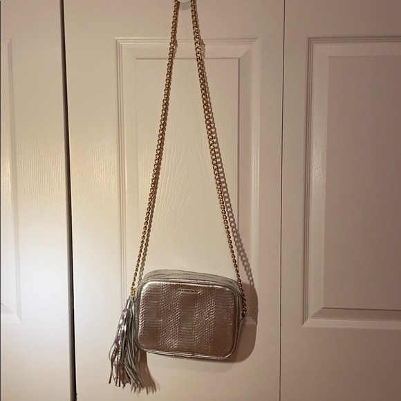 A silver over the shoulder purse